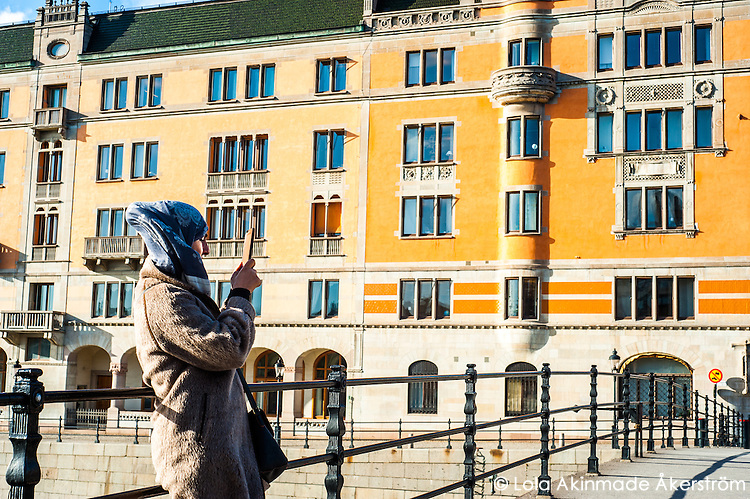 Tourist taking a photo - Street scenes from Stockholm
