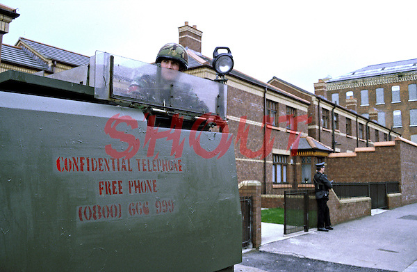 British Army soldier on armed foot patrol in armoured personnel carrier on the streets of Northern Ireland. They are performing a mobile vehicle checkpoint, stopping vehicles to check driving documents and search for arms and explosives. This image may only be used to portray the subject in a positive manner..©shoutpictures.com..john@shoutpictures.com