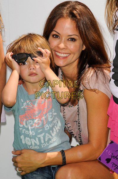 "BROOKE BURKE & son Shaya Braven Burke.arriving at the Los Angeles premiere of Dreamworks Animation's ""Shrek Forever After"" at Gibson Amphitheatre in Universal City, California, .May 16th, 2010.half length child mother mum mom smiling  kid family son .CAP/ROT.©Lee Roth/Capital Pictures"