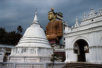 This statue of Buddha is located in southern Sri Lanka, near Matara, and is the largest statue in the country at 160 feet. It is part of the Wewurukannala Vihara temple and is shown here in 1996.