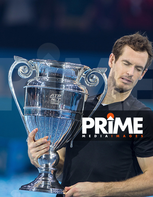 Andy Murray hits himself in the face as he lifts the Trophy during the Barclays ATP World Tour Finals FINAL match between ANDY MURRAY and NOVAK DJOKOVIC at the O2, London, England on 20 November 2016. Photo by Andy Rowland.