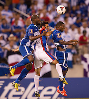 Osman Chavez (2) of Honduras goes up for a header with teammate Juan Carlos Garcia (6) and Yendrick Ruiz (12) of Costa Rica during the quarterfinals of the CONCACAF Gold Cup at M&T Bank Stadium in Baltimore, MD.  Honduras defeated Costa Rica, 1-0.