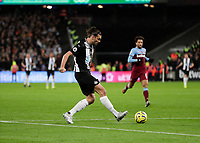 2nd November 2019; London Stadium, London, England; English Premier League Football, West Ham United versus Newcastle United; Andy Carroll of Newcastle United passing the ball into the box - Strictly Editorial Use Only. No use with unauthorized audio, video, data, fixture lists, club/league logos or 'live' services. Online in-match use limited to 120 images, no video emulation. No use in betting, games or single club/league/player publications