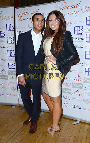 Lucien Laviscount & Lauren Goodger .Arrivals at the Luxury and Lifestyle Awards, Porchester Hall,  London, England..March 17th 2012.full length black dress suit cream beige hand on hip leather hand on hip.CAP/PP/JB.©Jane Burrows/PP/Capital Pictures.