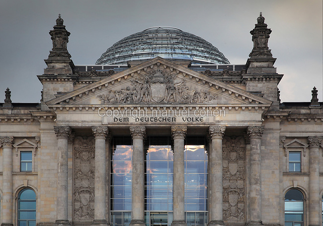 Reichstag building, opened 1894, seat of the German parliament and meeting place of the Bundestag, refurbished by Norman Foster 1990-99, including the addition of the huge glass dome, Berlin, Germany. A frieze below the pediment reads 'Dem Deutschen Volke' or To The German People. Picture by Manuel Cohen