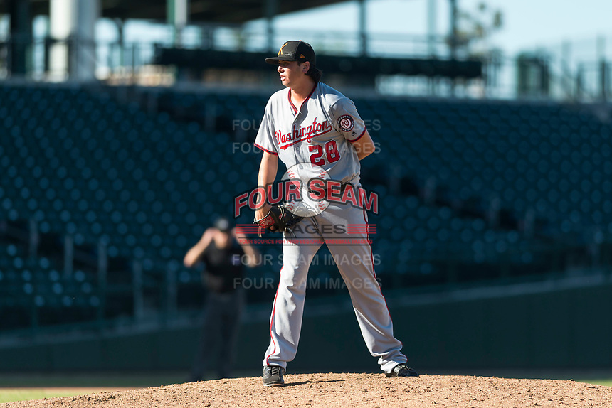 Salt River Rafters relief pitcher Jordan Mills (28), of the Washington Nationals organization, looks in for the sign during an Arizona Fall League game against the Mesa Solar Sox at Sloan Park on October 30, 2018 in Mesa, Arizona. Salt River defeated Mesa 14-4 . (Zachary Lucy/Four Seam Images)