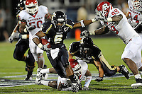 11 September 2010:  FIU running back Jeremiah Harden (6) evades Rutgers defensive end Jonathan Freeny (99) for extra yardage in the third quarter as the Rutgers Scarlet Knights defeated the FIU Golden Panthers, 19-14, at FIU Stadium in Miami, Florida.