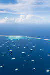 Toau Atoll, Tuamotu Archipelago, French Polynesia; aerial views of the Toau Atoll while flying from Rangiroa south to Fakarava