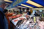Selling fish and shellfish from market in the Bastile area.