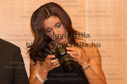 Reka Rubint looks on her camera during a press conference on her husband's franchise called Update in Budapest, Hungary. Tuesday, 18. May 2010. ATTILA VOLGYI