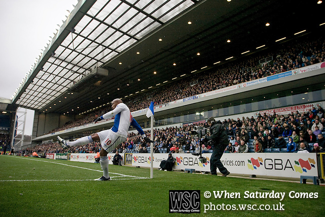 Blackburn Rovers player El Hadji Diouf taking a corner in front of the Jack Walker Stand during his team's Barclays Premier League match against visitors Aston Villa at Ewood Park. Blackburn won the match by two goals to nil watched by a crowd of 21,848. It was Rovers' first match under the ownership of Indian company Venky's.