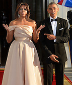 U.S  President Barack Obama (R) and First Lady Michelle Obama gesture to photographers as they await the arrival of leaders from the five Nordic countries for a State Dinner, at the White House, May 13, 2016, in Washington, DC. They leaders were expected to discuss terrorism, the environment, Artic issues and trade.    <br /> Credit: Mike Theiler / Pool via CNP