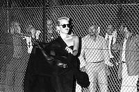 Roma   Luglio 1985  .Sfilata di Moda per l'Estate Romana..Gli uomini sono separati da una rete.Rome Luglio 1985  .Parade of Fashion for the Roman summer  .The men are separate from a grid.