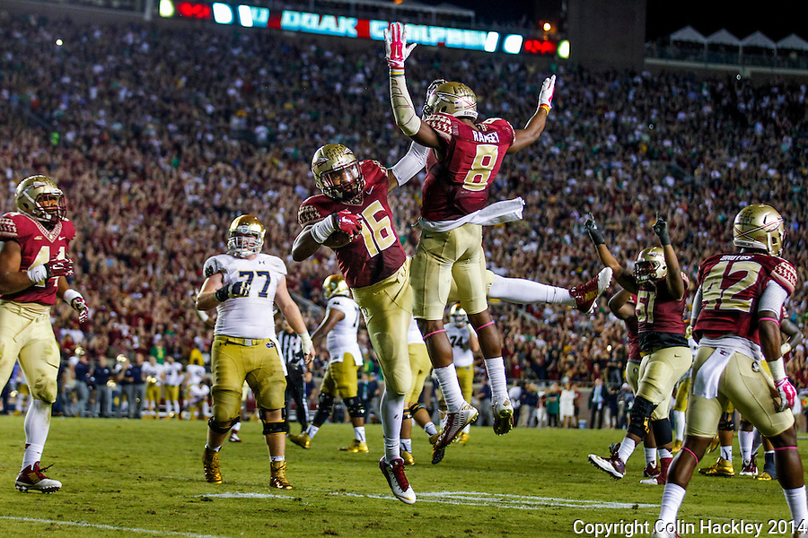 TALLAHASSEE, FLA. 10/18/14-FSU-ND101814CH-Florida State's Jacob Pugh (16) center, celebrates with Jalen Ramsey after Pugh intercepted a Notre Dame pass in the end zone ending the Irish's hopes of beating the Seminoles during fourth quarter action Saturday at Doak Campbell Stadium in Tallahassee. The Seminoles beat the Fighting Irish 31-27.<br /> COLIN HACKLEY PHOTO