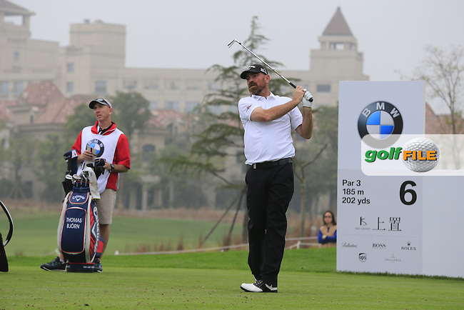 Thomas Bjorn (DEN) tees off the 6th tee during Saturay's Round 3 of the 2014 BMW Masters held at Lake Malaren, Shanghai, China. 1st November 2014.<br /> Picture: Eoin Clarke www.golffile.ie
