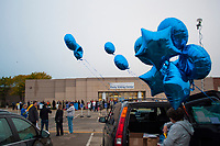 Helium-filled balloons festoon a van in the parking lot of an early voting center in Columbus, Ohio,  on the first day of early voting in the state.
