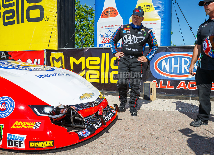 Apr 23, 2017; Baytown, TX, USA; NHRA funny car driver Robert Hight reacts as he looks at damage to his car after hitting the center line timing blocks during the final round of the Springnationals at Royal Purple Raceway. Mandatory Credit: Mark J. Rebilas-USA TODAY Sports