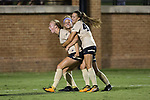 Hannah Betfort (left) is mobbed by teammates Bayley Feist (center), and Bri Carney (45) after scoring the eventual game-winning goal during second half action against the South Carolina Gamecocks at Spry Soccer Stadium on August 24, 2017 in Winston-Salem, North Carolina.  The Demon Deacons defeated the Gamecocks 3-2.  (Brian Westerholt/Sports On Film)