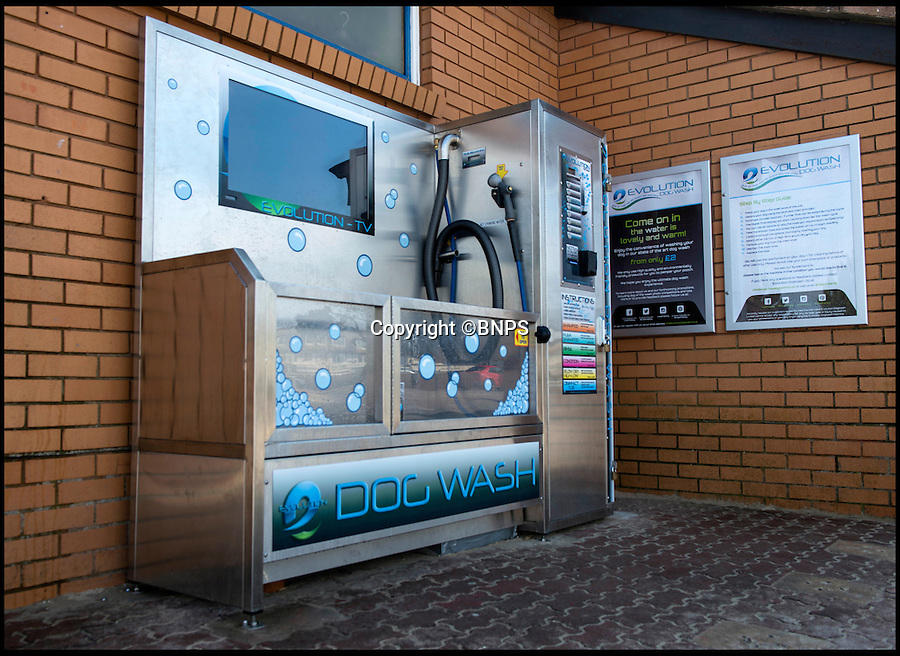 BNPS.co.uk (01202 558833)<br /> Pic: TomWren/BNPS<br /> <br /> Doggy style...<br /> <br /> A state-of-the-art coin operated dog wash that can turn a dirty mutt into a pampered pooch in minutes has been set up on a British beach for the first time.<br /> <br /> The Evolution Dog Wash is already proving a hit with dog walkers since it was introduced in the posh Sandbanks area of Poole, Dorset, a week ago.<br /> <br /> It allows owners to achieve 'pawfection'  and give their pets the full services of a professional groomer for the cost of a couple of pounds.<br /> <br /> The self-contained unit is made from 'aircraft grade' stainless steel and has the ability to rinse, shampoo, condition, de-flea and blow-dry a canine companion.