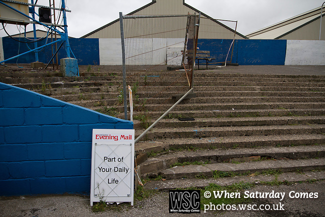 Barrow AFC 0 Newport County 3, 15/09/2012. Furness Building Society Stadium, Football Conference. A newspaper advert in front of a disused section of the terracing at Barrow AFC's Furness Building Society Stadium during the Barrow (white shirts) v Newport County Conference National Fixture. Newport County eventually won the match by 3-0, watched by 802 spectators. Both Barrow and Newport County from Wales were former members of the Football League in England. Photo by Colin McPherson.