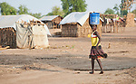 A woman carries water in the Doro Refugee Camp in Maban County, South Sudan. Doro is one of four camps in Maban that together shelter more than 130,000 refugees from the Blue Nile region of Sudan. Jesuit Refugee Service provides educational and psycho-social services to both refugees and the host community. <br /> <br /> Misean Cara supports the work of JRS in the Maban camps.