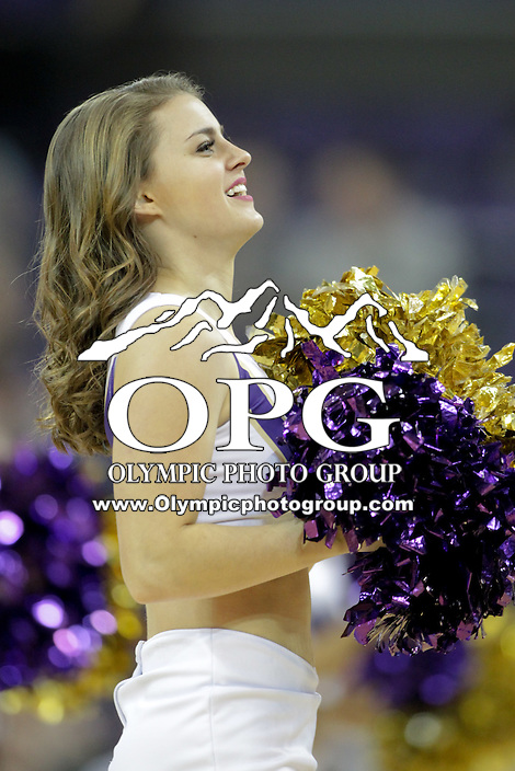 Dec 28, 2015:  Washington cheer member Paige Snider entertained fans during a TV timeout.   Washington defeated UC Santa Barbara 83-78 at Alaska Airlines Arena in Seattle, WA.