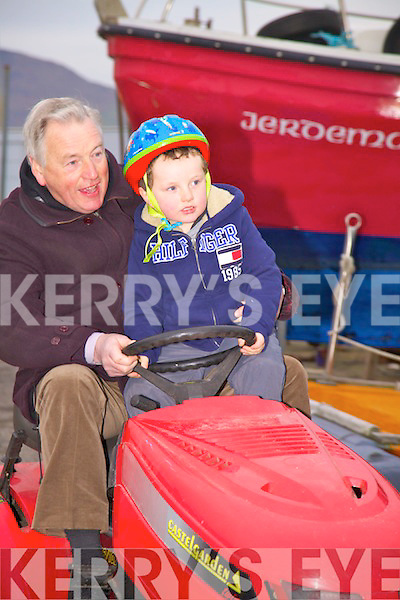 Richard Foran with his grandson Adam taking part in the Lawnmower Race in Valentia on Friday...Ref Sinead