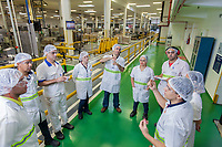Multinational cosmetics company headquartered in France L`Oreal plant in Rio de Janeiro, Brazil - daily performance production meeting - employees from different departments (quality control, maintenance, manufacturing) analyze how to improve line production efficience.