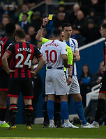 Brighton & Hove Albion's Florin Andone is shown a yellow card by referee Kevin Friend<br /> <br /> Photographer David Horton/CameraSport<br /> <br /> The Premier League - Brighton and Hove Albion v Bournemouth - Saturday 13th April 2019 - The Amex Stadium - Brighton<br /> <br /> World Copyright © 2019 CameraSport. All rights reserved. 43 Linden Ave. Countesthorpe. Leicester. England. LE8 5PG - Tel: +44 (0) 116 277 4147 - admin@camerasport.com - www.camerasport.com