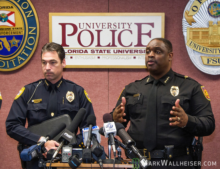 Tallahassee police chief Michael Deleo, left and FSU police chief David Perry talk with the media about a shooting outside the Strozier library on the Florida State University campus in Tallahassee, FL. Nov 20, 2014.   Three students were wounded and the gunman was shot and killed by police officers. (AP Photo/Mark Wallheiser)