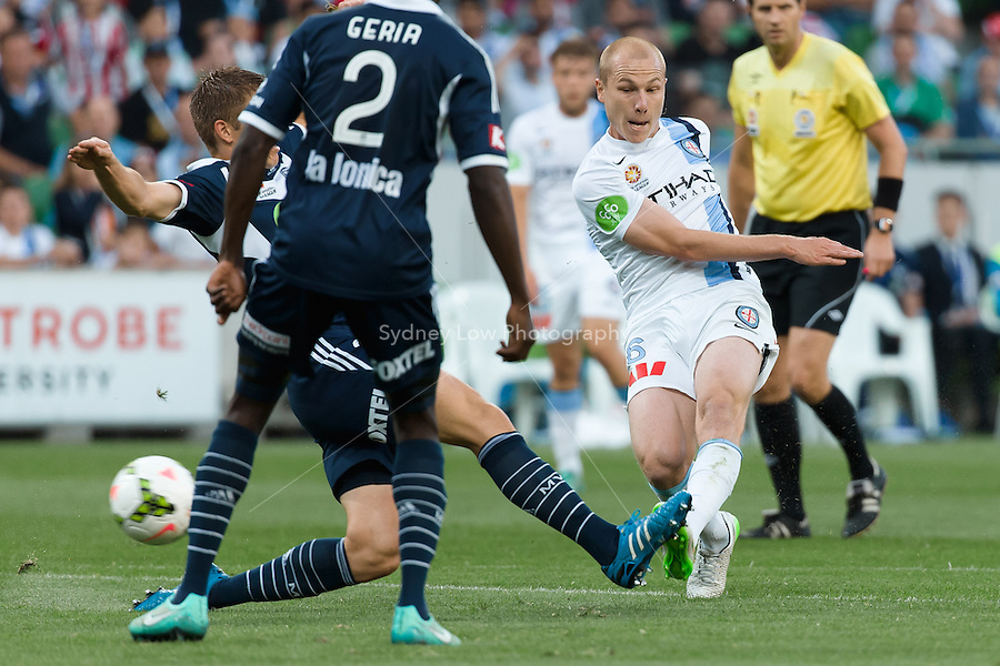 Aaron MOOY of Melbourne City kicks the ball in round 11 A-League match between Melbourne City and Melbourne Victory at AAMI Park in Melbourne, Australia during the 2014/2015 Australian A-League season. City def Victory 1-0