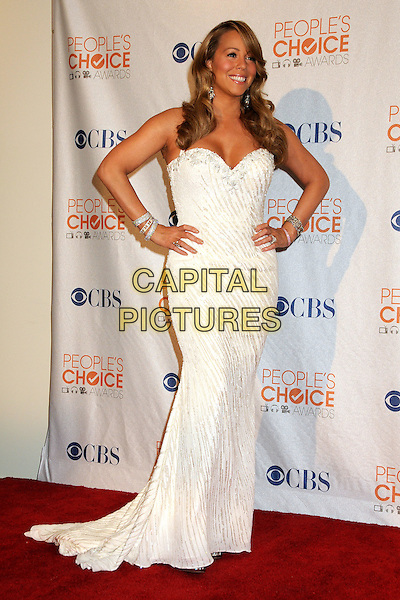 MARIAH CAREY .36th Annual People's Choice Awards - Press Room held at the Nokia Theatre LA Live, Los Angeles, California, USA, 6th January 2010..full length strapless dress long maxi gown white hands on hips beaded bracelets .CAP/ADM/BP.©Byron Purvis/Admedia/Capital Pictures