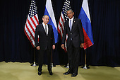 President Vladimir Putin of Russia and United States President Barack Obama pose for photographs before the start of a bilateral meeting at the United Nations headquarters September 28, 2015 in New York City. Putin and Obama are in New York City to attend the 70th anniversary general assembly meetings.  <br /> Credit: Chip Somodevilla / Pool via CNP
