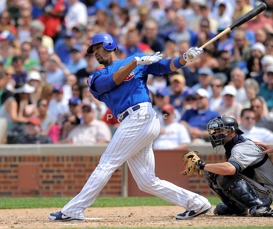 DERREK LEE, of the Chicago Cubs, in action during the Cubs game against the Milwaukee Brewers on July 3, 2009 at Wrigley Field in Chicago, IL.  The Cubs win 2-1.