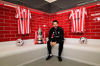 Lincoln City manager Danny Cowley with the Emirates FA Cup in the changing room of Lincoln City's new Elite Performance Centre<br /> <br /> Photographer Chris Vaughan/CameraSport<br /> <br /> The official opening of Lincoln City's new Elite Performance Centre - Wednesday 7th November 2018 - Scampton, Lincolnshire<br /> <br /> World Copyright © 2018 CameraSport. All rights reserved. 43 Linden Ave. Countesthorpe. Leicester. England. LE8 5PG - Tel: +44 (0) 116 277 4147 - admin@camerasport.com - www.camerasport.com