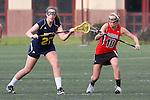Santa Barbara, CA 02/18/12 - Maddie Palmer (Michigan #27) and Emma Goodnow (Georgia #10) in action during the Georgia-Michigan matchup at the 2012 Santa Barbara Shootout.  Georgia defeated Michigan 12-10.