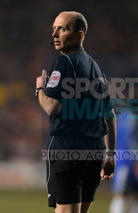 Referee Mike Riley