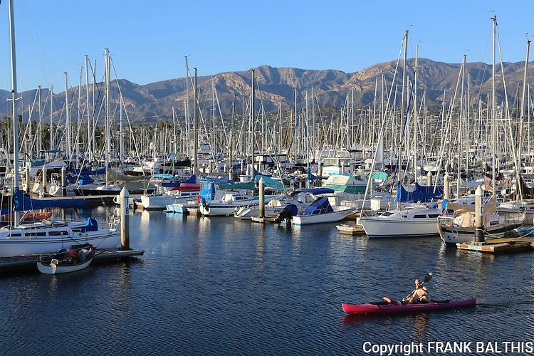 Man kayaking at Santa Barbara Harbor