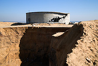 Beit Lahia, Gaza strip, 20 Nov 2009.A major water reservoir has been destroyed by the Israeli Air Force during the 'Cast Lead' operation. .Almost a year later nothing has been done to rebuild the facility. Water ressources and infrastructure is notoriously unsufficient to cope with Gaza's pupulation of a million and a half