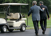 CAMP DAVID, MD - JULY 29: (AFP OUT) U.S. President George W. Bush (L) and British Prime Minister Gordon Brown walk toward a golf cart after he arrived July 29, 2007 in Camp David, Maryland. The two leaders will attend meetings to discuss many topics including the situation in Iraq and Afghanistan.  (Photo by Mark Wilson/Getty Images)