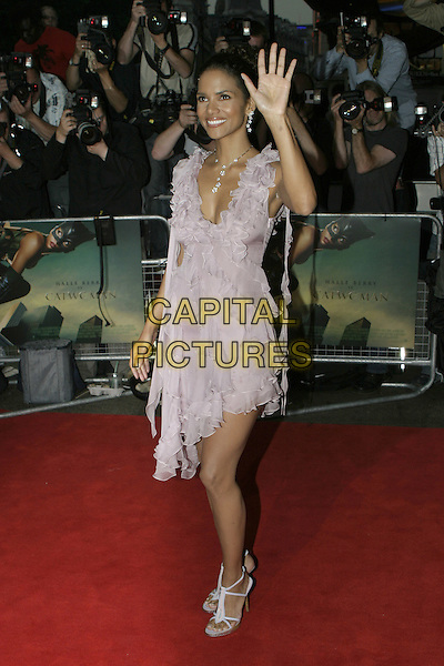 "HALLE BERRY.""Catwoman"" film premiere arrivals .Vue Cinema, Leicester Square.London 03 August 2004.full length, waving, gesture, lilac, purple, flowing, summery dress, ruffles.www.capitalpictures.com.sales@capitalpictures.com.© Capital Pictures."