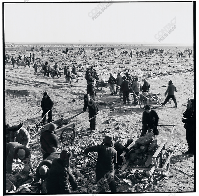 """Educated youth"" and local peasants collaborate to till and irrigate the frozen land in preparation of the season's planting. Chaoyang commune, Shuangcheng county, 17 December 1974"