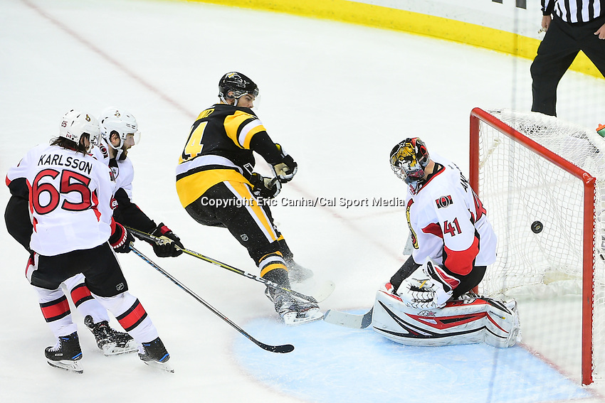 May 25, 2017: Pittsburgh Penguins left wing Chris Kunitz (14) shoots on Ottawa Senators goalie Craig Anderson (41) during game seven of the National Hockey League Eastern Conference Finals between the Ottawa Senators and the Pittsburgh Penguins, held at PPG Paints Arena, in Pittsburgh, PA. The Pittsburgh Penguins defeat the Ottawa Senators 3-2 in double overtime to win the NHL Eastern Conference Championship and advance to face the Nashville Predators in the Stanley Cup Finals.  Eric Canha/CSM