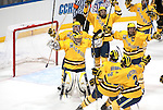 March 26,  2011                      Michigan teammates swarm Michigan goalie Shawn Hunwick (31, center) after the buzzer sounded as they defeated Colorado College 2-1 in the championship game of the NCAA Division 1 Men's West Regional Hockey Tournament, on Saturday March 26, 2011 at the Scottrade Center in downtown St. Louis.