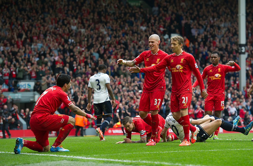 Liverpool's Martin Skrtel and Lucas Leiva mistakingly think Luis Suarez has scored their sides fourth goal<br /> <br /> Photo by Stephen White/CameraSport<br /> <br /> Football - Barclays Premiership - Liverpool v Tottenham Hotspur	 - Sunday 30th March 2014 - Anfield - Liverpool<br /> <br /> &copy; CameraSport - 43 Linden Ave. Countesthorpe. Leicester. England. LE8 5PG - Tel: +44 (0) 116 277 4147 - admin@camerasport.com - www.camerasport.com