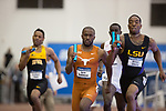 COLLEGE STATION, TX - MARCH 11: Byron Robinson of Texas and Michael Cherry of LSU  compete in the men's 4x400 meter relay during the Division I Men's and Women's Indoor Track & Field Championship held at the Gilliam Indoor Track Stadium on the Texas A&M University campus on March 11, 2017 in College Station, Texas. (Photo by Michael Starghill/NCAA Photos/NCAA Photos via Getty Images)