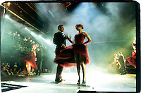 Dancers tango on stage at Senor Tango, a restaurant who offers dinners with tango shows, in Buenos Aires, February 2001. Photo by Quique Kierszenbaum