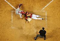 Apr. 14, 2009; Phoenix, AZ, USA; Home plate umpire Jim Reynolds looks on as Arizona Diamondbacks base runner Stephen Drew is tagged out by St. Louis Cardinals catcher Yadier Molina in the ninth inning at Chase Field. Mandatory Credit: Mark J. Rebilas-