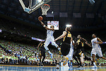 03 December 2014: North Carolina's J.P. Tokoto (13) take a layup. The University of North Carolina Tar Heels played the University of Iowa Hawkeyes in an NCAA Division I Men's basketball game at the Dean E. Smith Center in Chapel Hill, North Carolina. Iowa won the game 60-55.