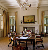 The formal dining room is traditionally furnished